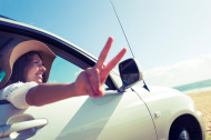 stock-photo-36510110-woman-making-a-peace-sign-while-driving